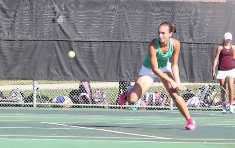 Varsity tennis match against St. James Academy