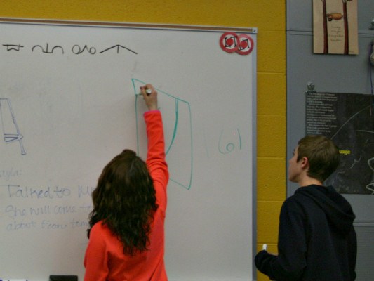 Students in National Art Honors Society brainstorm ideas.