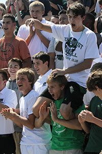 Juniors cheer their class to victory in the class competition at the first outdoor assembly.