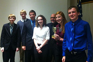 The History Club poses with its trophy after winning the Truman Library High School Trivia Contest last October.