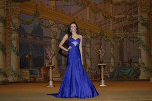 Madison Moore poses onstage during Evening Gown at the Miss Kansas Teen USA 2013 pageant, where she finished in 6th place and also received the Congeniality Award and People's Choice Award.