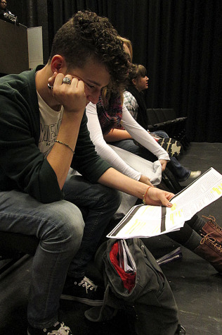 Junior Sam Kalmus studies his lines in preparation for the show.