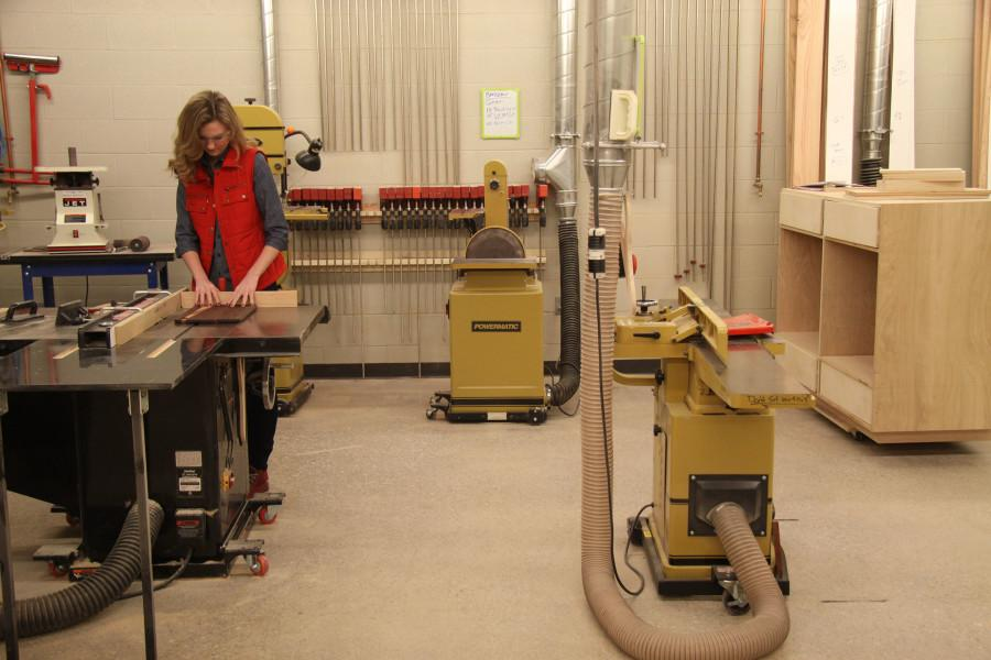 Junior Leah Joseph uses the table saw in her woodshop class.