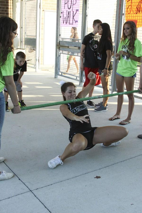 Junior Lindsay Hissong tries to maintain her balance as she competes in the limbo contest.