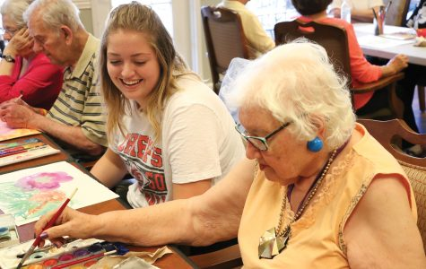 Senior Londyn Bogseth gets certified to teach people with Alzheimer's to paint