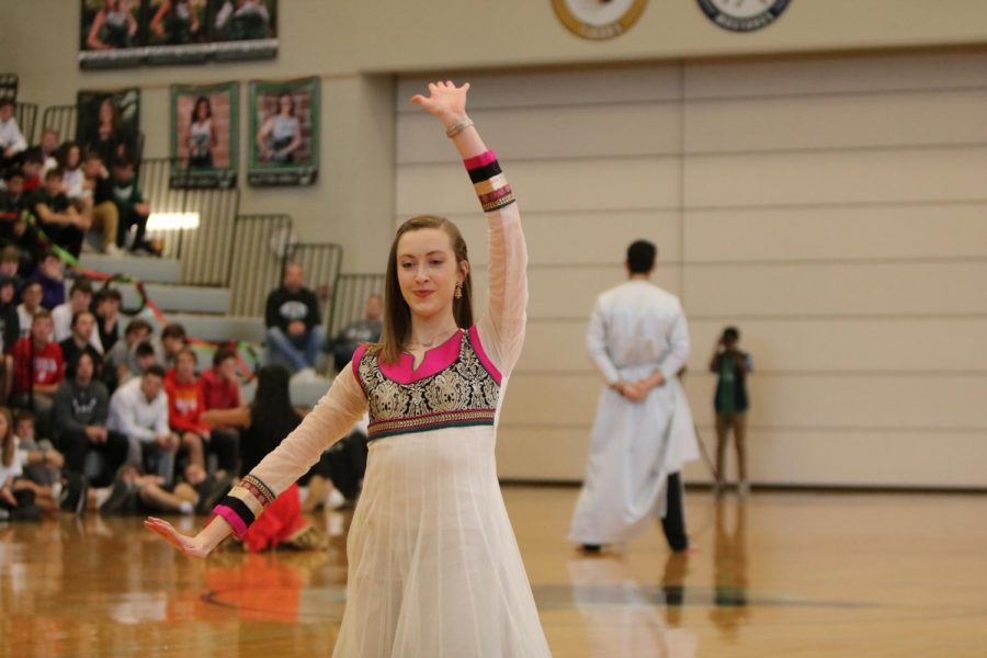 Senior+Lauren+Dudley+raises+her+hands+at+the+end+of+the+Bollywood+dance.+
