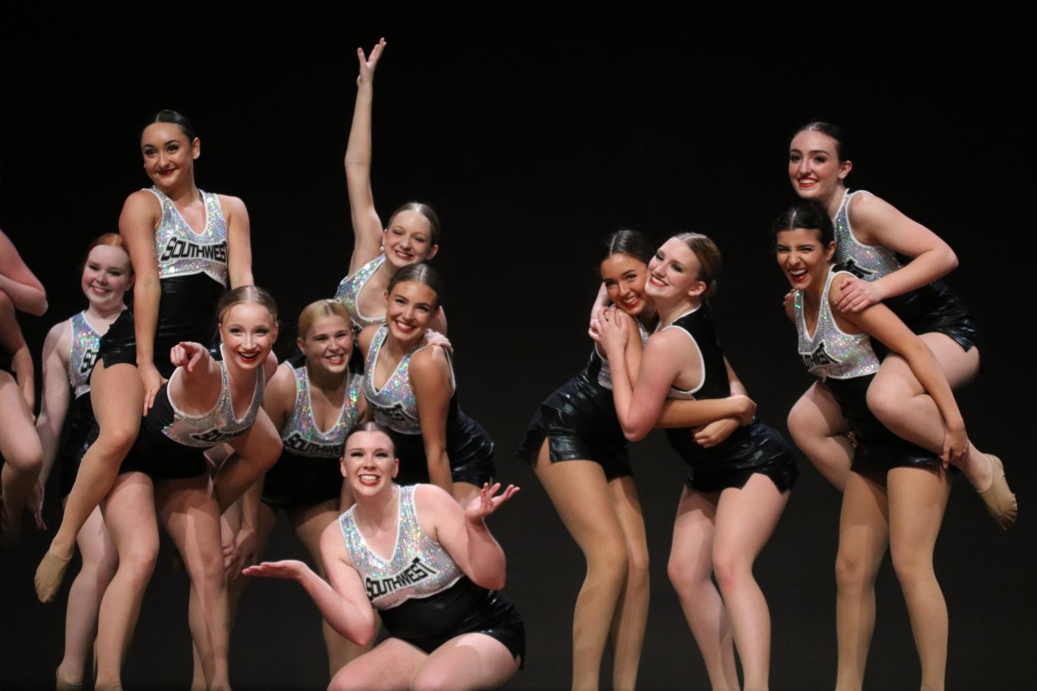 Happy as can be, the Glitter Girls finish out their performance at the Spring Show.