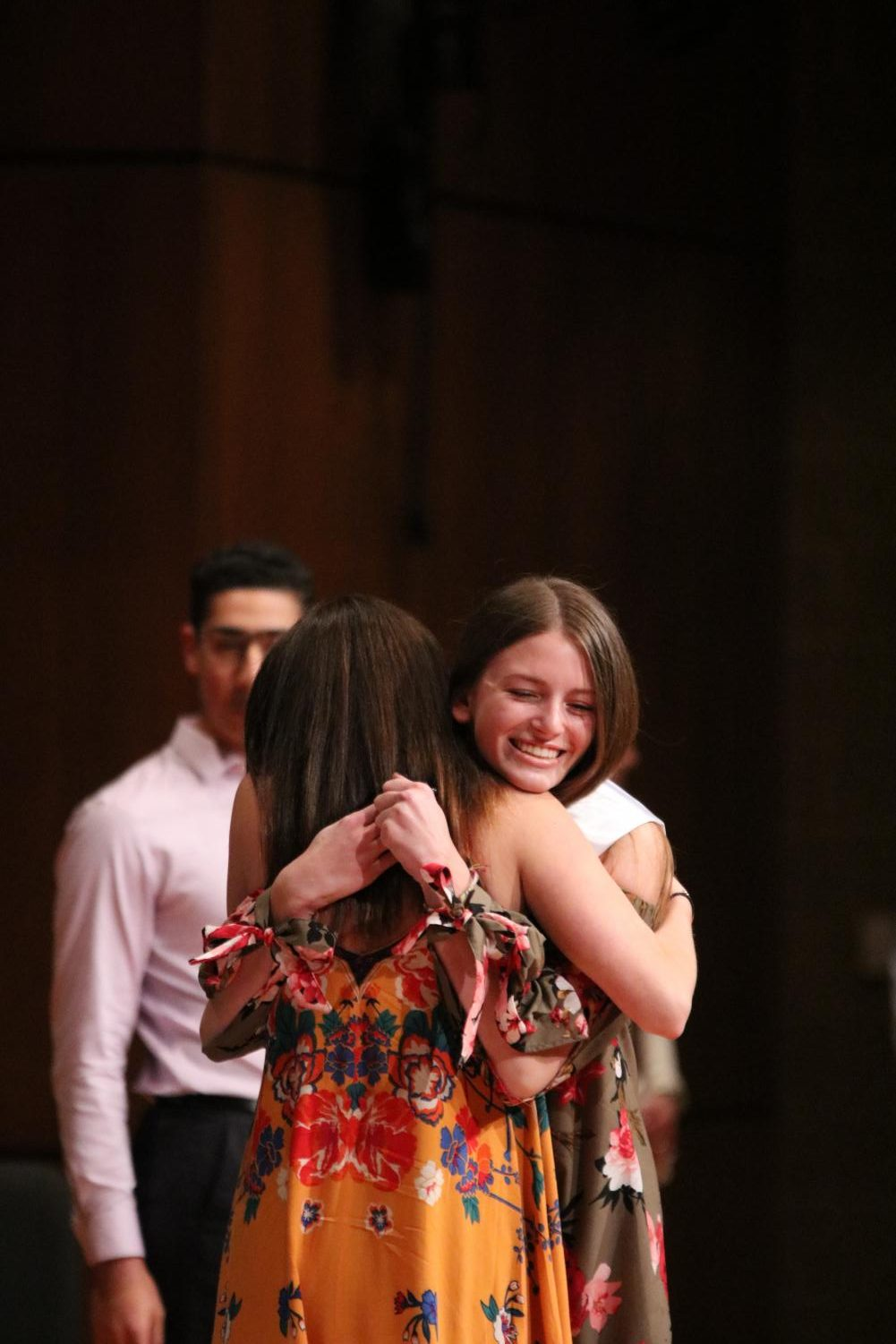 With open arms, senior Kendall Rintamaki hugs Ashley Schueler in celebration.