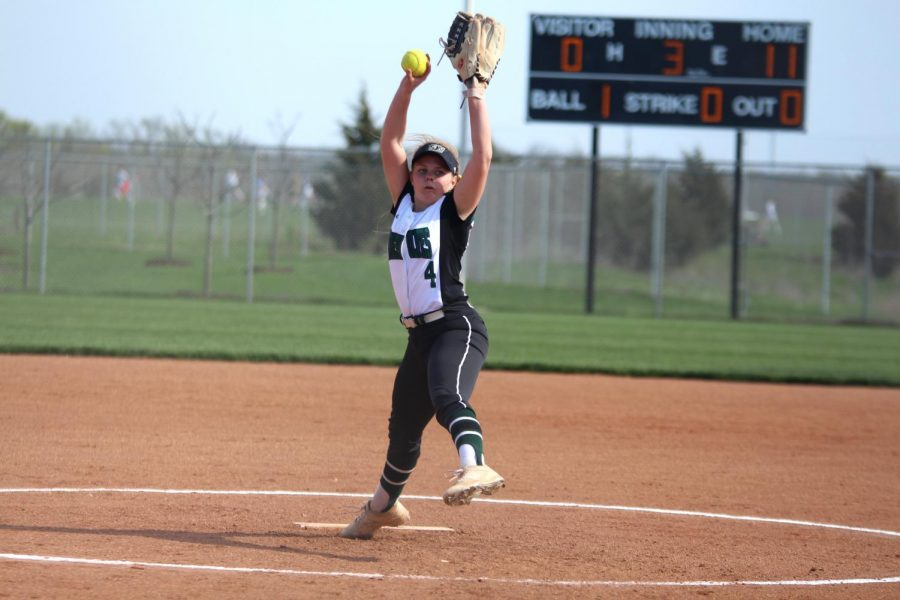 Pitching the ball, freshman Jessica Bell focuses on the opposing teams batter.  The junior varsity team played at home against Blue Valley Northwest High School on Tuesday April 16.
