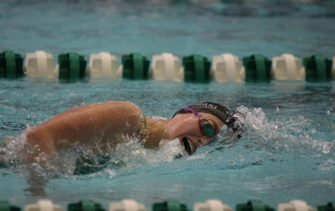 Goggles on, senior Kendal Rintamaki competes in her race to improve her time.