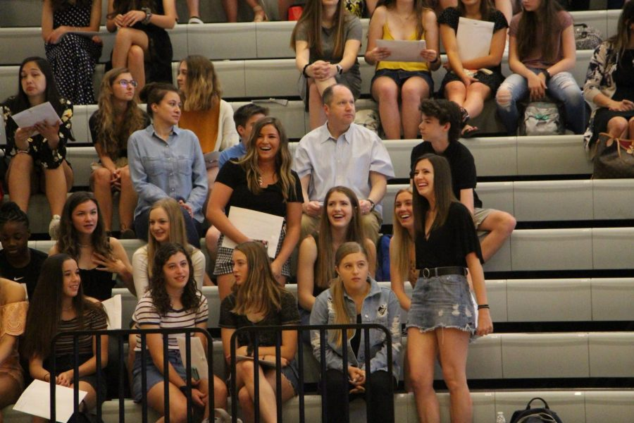 After+being+recognized+for+their+successes%2C+Brooke+Davis+and+Carson+Craft+laugh+in+the+bleachers.