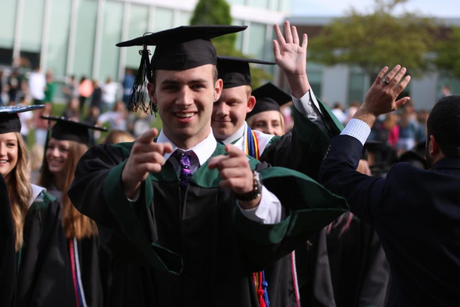 While walking with his class, senior Tommy John Scanlon points at the camera.