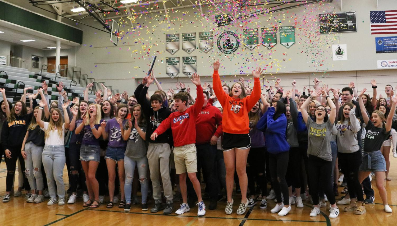 Hands in the air, the Southwest seniors shoot confetti cannons off at their senior picnic.