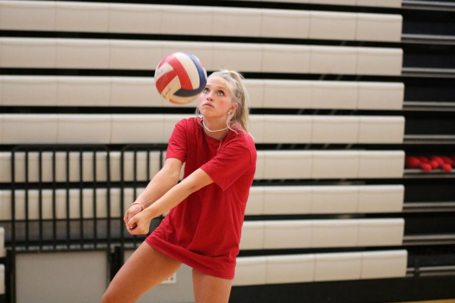 "Bumping the ball, senior Miranda Nolte tries out for her final season of high school volleyball at practice on Aug. 19. Nolte said she is excited to get to know all of the new girls on the team and have a lot of fun during all of the home games. ""I think our goal for our team is to keep the intensity but still enjoy ourselves on and off the court,"" Nolte said."