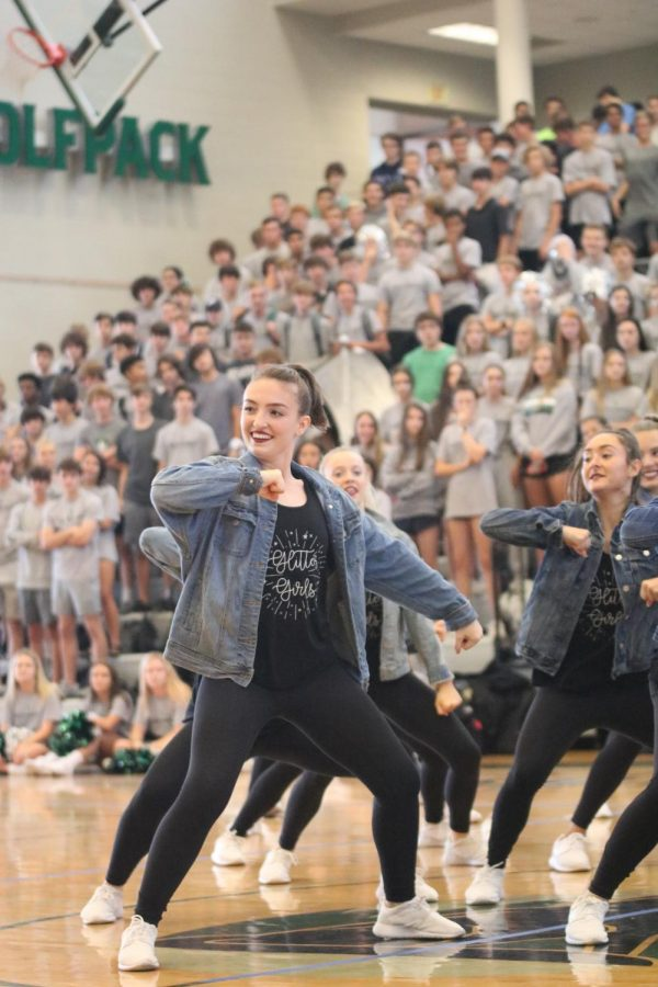 Senior+Talia+Epps+dances+in+the+front+row+of+the+Glitter+Girls+routine+at+the+Fall+Sports+Assembly+on+Sept.+20.