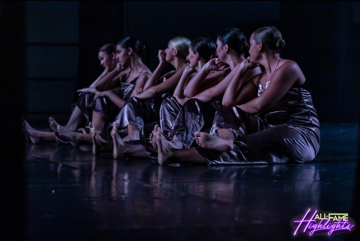 Junior Jessica Slezak and her group preform on stage at the Hall of Fame competition. Photo courtesy of Jessica Slezak.