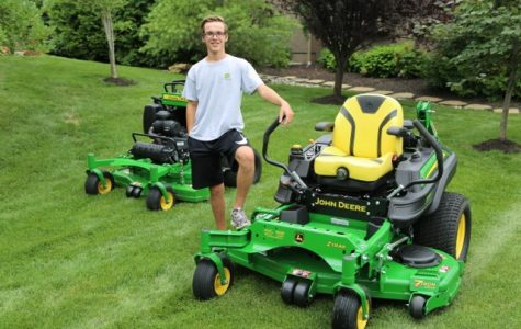 Trevor Schwartz poses with his tractors for a photoshoot in Mills Farm.  Photo courtesy of Trevor Schwartz