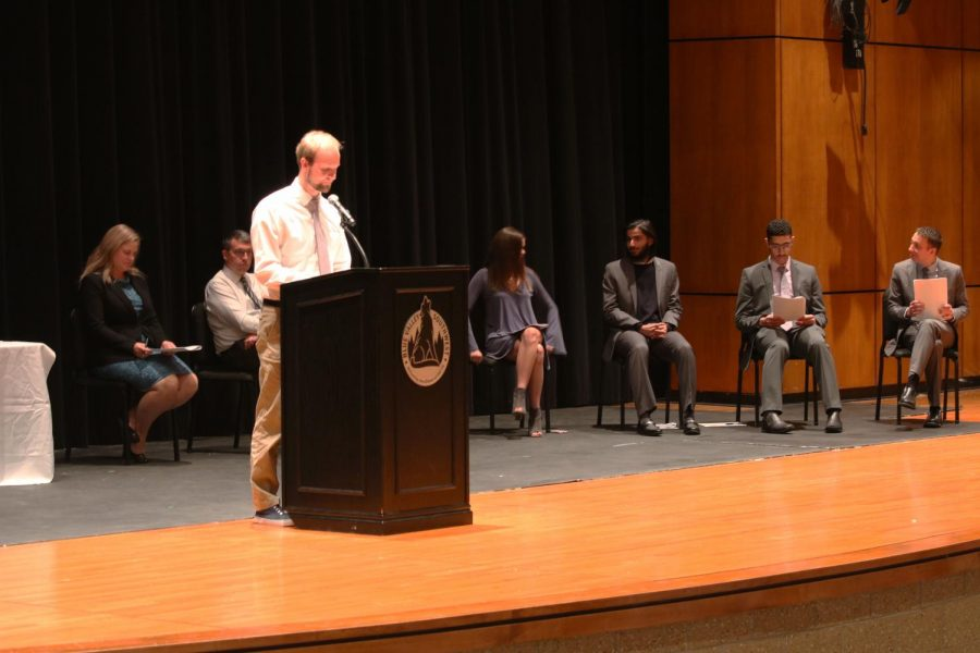 History+teacher%2C+Brandon+Bishop+gives+a+speech+about+the+four+pillars+of+NHS+as+the+honorary+speaker.