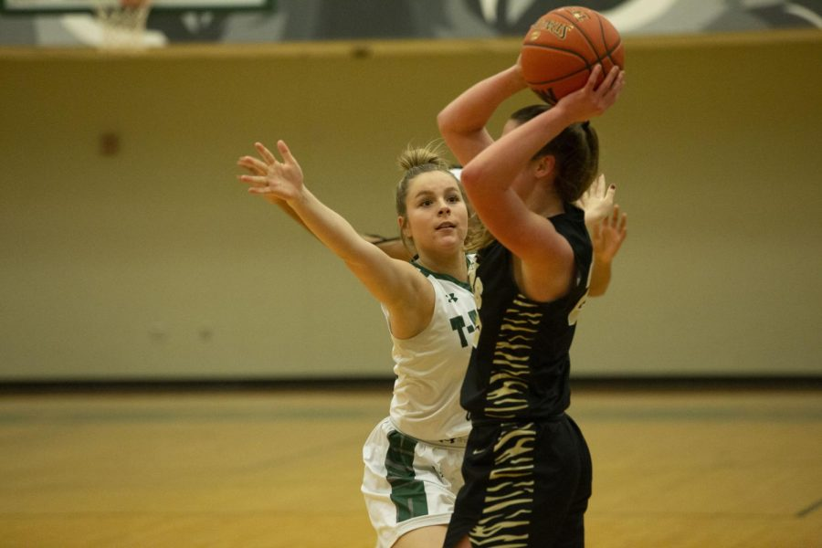 Senior Peyton Justice moves in front of her opponent to block a pass.