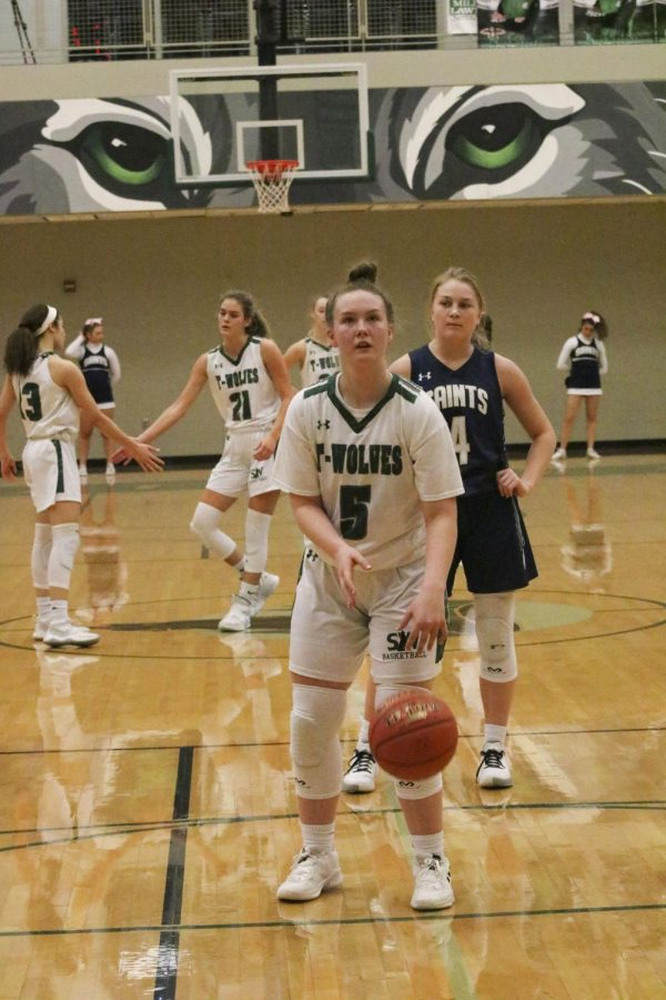 Girls Varsity basketball player sophomore Abby Augustine prepares to make a foul shot at the game on Feb. 11 2020.