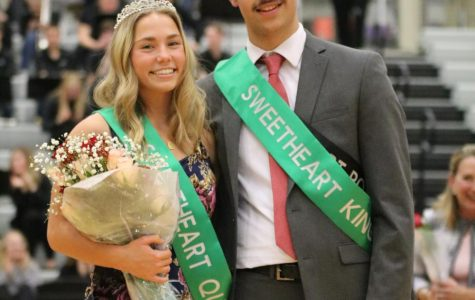 Seniors Faris B'Dair and Emerson Ralston stand together as Sweetheart king and queen.