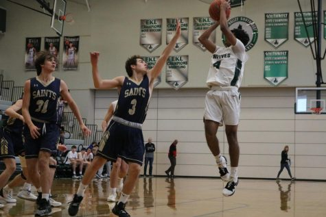 Junior Shay Patel takes the jump shot despite the opposing player