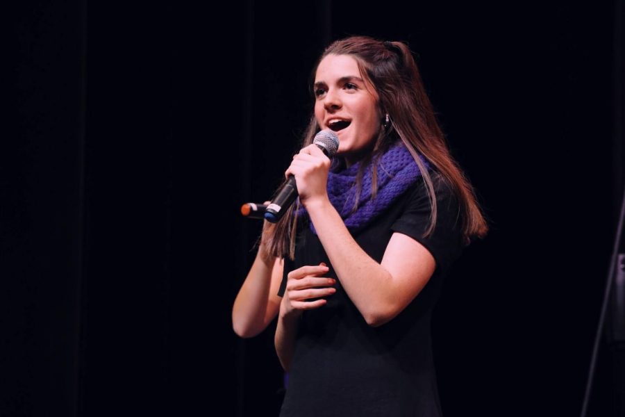 Junior+Ashley+Hendricks+sings+alongside+KC+A+Cappella+at+a+recent+competition.