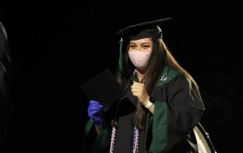 Holding her diploma, senior Josette Pinto walks across the stage. Pinto served as student council president her senior year. Photo by Lianna Shoikhet.
