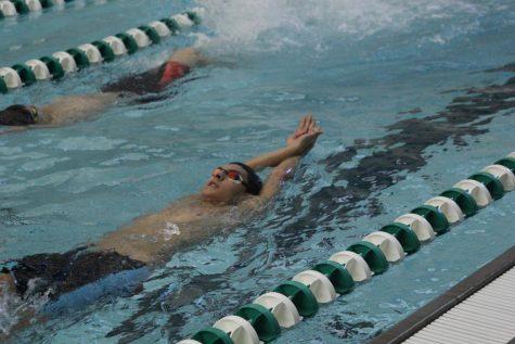 Senior Yaseen El-Demerdash shares the lane as he practices the backstroke.