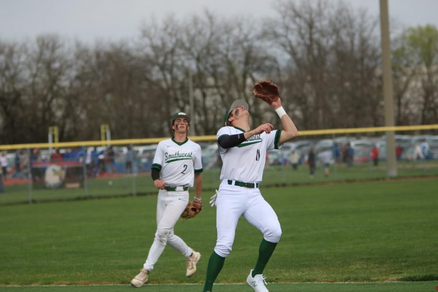 Senior Carson Hornung calls off junior Cooper Kelly on a fly ball in shallow left field.