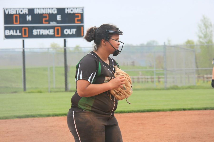 Hand in glove, senior Kayden Williams awaits for the batter to be inside the box.