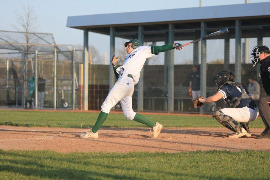 In full swing, junior Caden Hacker bats to keep the JV team undefeated.