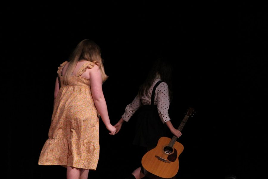 Junior Carolyn Brotherson and Senior Alyssa Cangelose exit the stage after performing their duet.