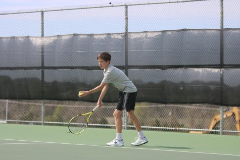 Freshman Emmett Wirth has the ball in hand as he prepares to serve.