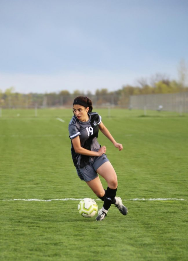 Concentrated on the game, freshman Mellek Ibrahim looks to pass. The girls varsity soccer team won 4-0 against Aquinas on April 13.