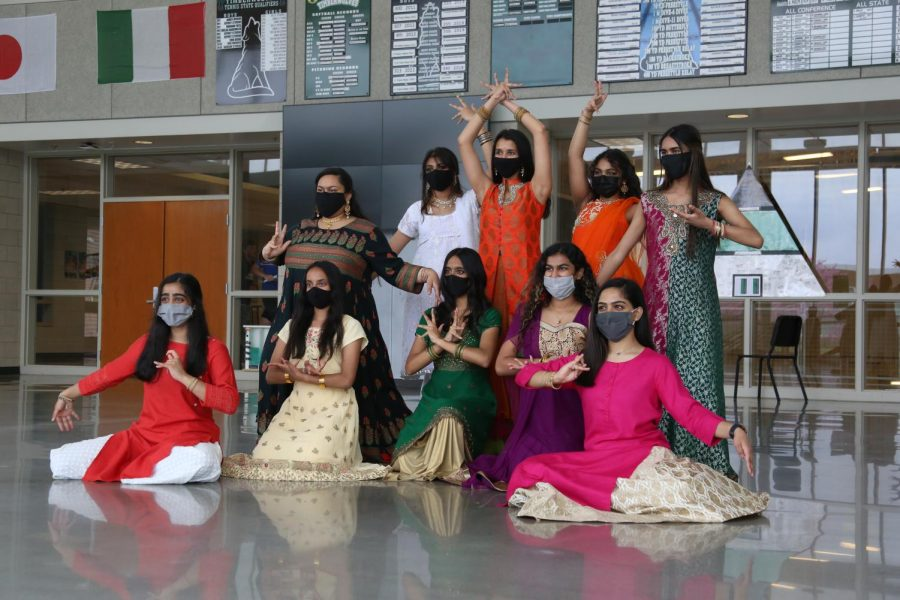 Posed for the camera, the Bollywood dancers end their performance.