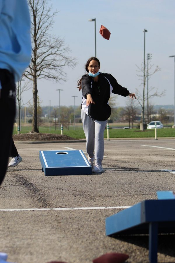 Eyes on the board, junior Molly Heidrick frees the cornhole bag at Cornhole for a Cure on April 24, 2021. Heidrick was a part of Wolf Pack Crew as well as a participant in Cornhole for a Cure.