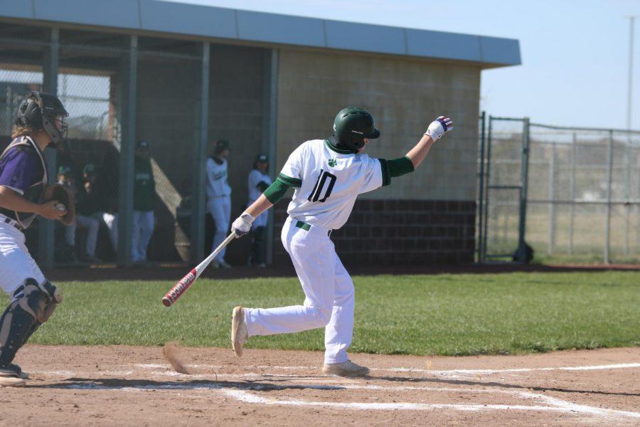 Junior Kaden Moore after a swing.