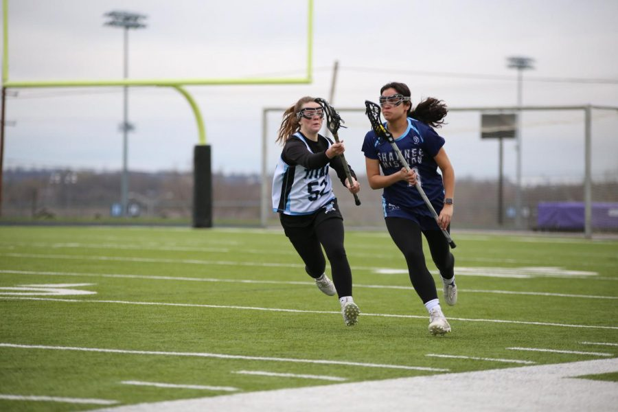 Playing defense, senior Sydney Meschwitz chases her opponent in efforts to steal the ball.