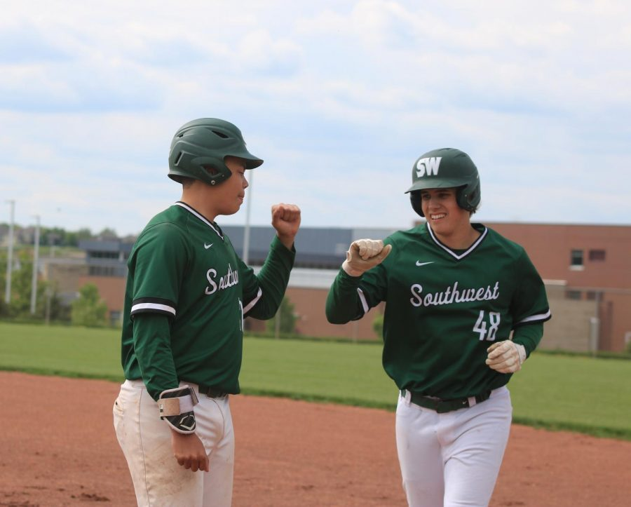 Fists ready to bump, sophomores Kai Barnhart and Jacob Dickey celebrate a good game.