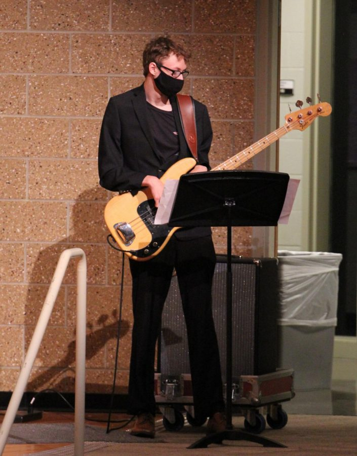 Focused on the music, senior Brayden Silliman plays the electric guitar. The jazz band accompanied the choir on May 4.