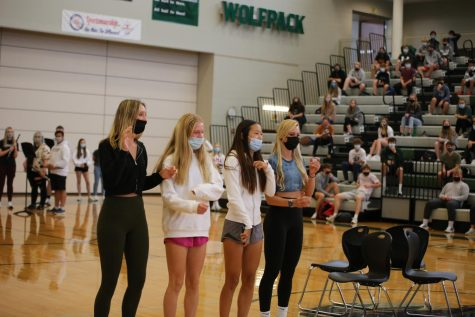 Freshmen girls Taylor Gerard, Alex Laurie, Hope Kim, and Wolfpack Crew member sophomore Cece Bahr renegade at the freshman assembly.