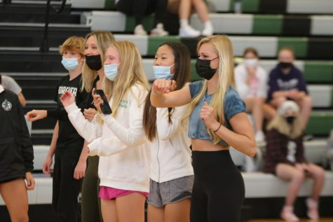 Dancing in line, sophomore Cece Bahr dances to the Renegade on April 28th at the freshmen assembly.