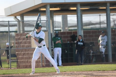 Senior Tristen Everard looks pitcher in the eyes ready to swing