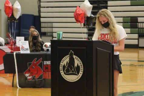 Teammate behind her, senior Lexie Ruf officially commits to the University of Central Missouri. Ruf continued her soccer and academic career.