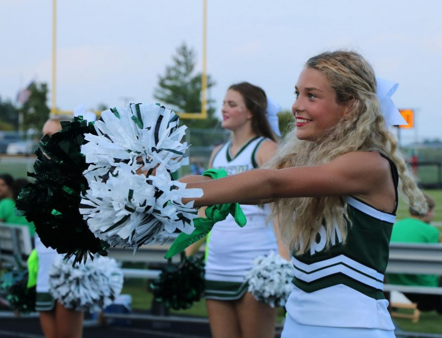 Freshman Camille Mitchum cheers at the senior night game on Sept. 3