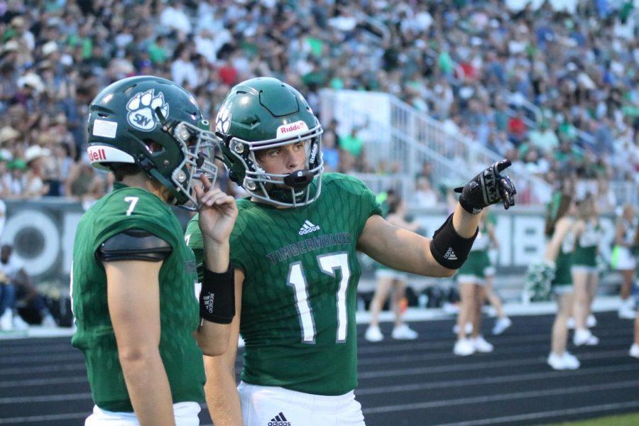 Senior Davis Brogan talks with a teammate during the senior night football game on Sept. 3.
