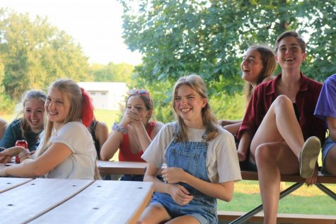 Seniors Kyra Tatge, Sydney Gilman and Kathleen Speer react to the announcement of the Spring Musical, Footloose at the Theater Picnic on Sept. 12.