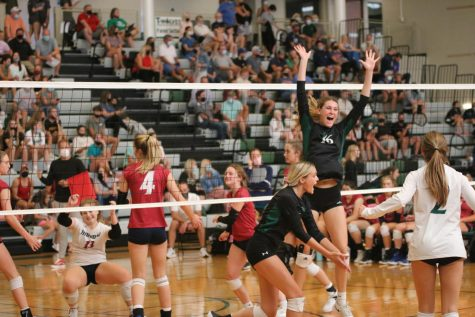 Junior Hailey Auslander celebrates with her teammates after a kill.
