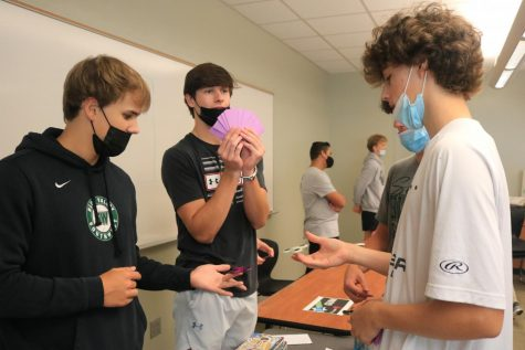 Senior Zach Atkins flaunts his profit during the Marketplace activity in Business Essentials.
